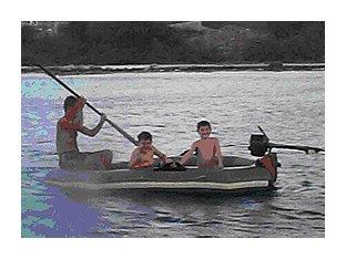 Three men in a dinghy