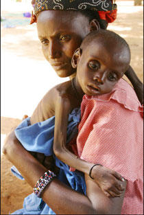 donna nigeriana con bambino