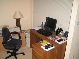 Desk. LCD Monitor, 3 speakers, subwoofer underneath.