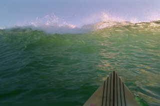 Popping over the lip of a wave at Beacons Beach