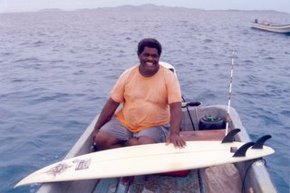 Big John posing with my surfboard on his boat