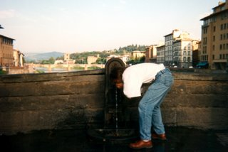 Greg drinking from Ponte Vecchio Bridge