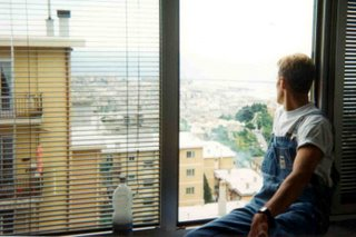 Noah looking out of window from Genoa hilltop hostel