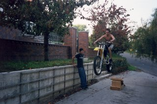 My brother, Joel, jumping his motorcycle in the driveway