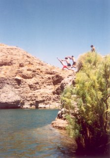 Jumping off a rock in Lake Mohave