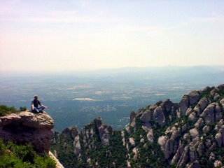 Noah meditating on the rocky cliffs of Montserrat