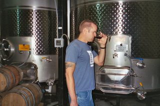 Noah sniffing wine at Wilson Creek Winery