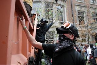 Protester defacing truck