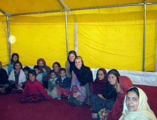 Katie and Amber meet with the women of the tent village in Balakot.