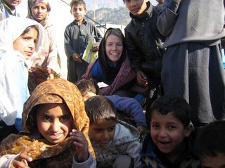 Katie plays with children at the Child Friendly Space in Ghari Habibullah.