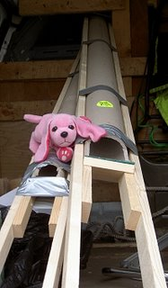 Wood, gaffer tape and a cuddly toy.