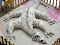 Sand sculpture of a dragon.