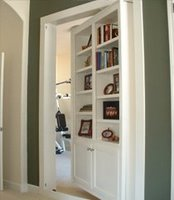 Hinding a doorway with a bookcase.