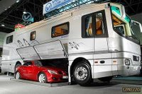 RV with parking space for a car.