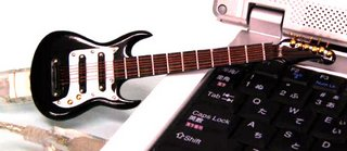 Mini-guitar flash drive.