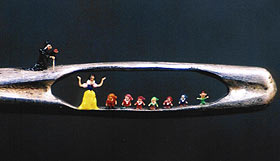 Snow White and the 7 dwarfs in the eye of a needle.