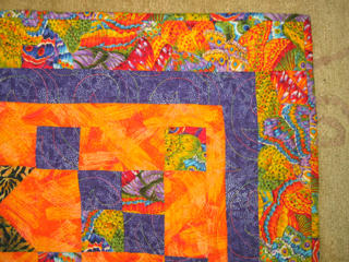 a closeup that shows the quilting pattern and thread colors in detail