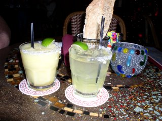 A frozen passion fruit margarita and my regular margarita on the rocks!