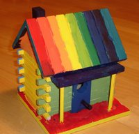 Rainbow coloured bird house front
