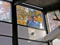 man in window