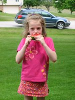 Grace eating watermelon