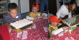 Blowing out the candles on the cupcake cones; A slice of ice cream and a scoop of cake in a cone, with a chaser of Seven Down, which is SevenUp with a hold punched in the bottom of the can and a straw inserted