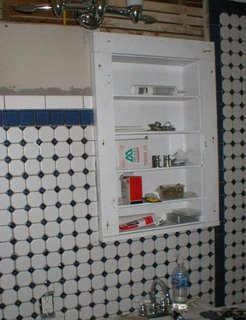 tiled wall with medicine cabinet