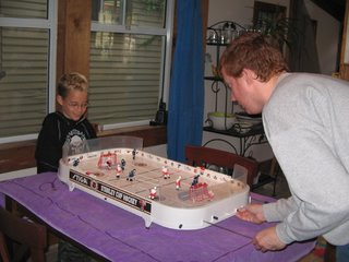 trey and alex playing table hockey