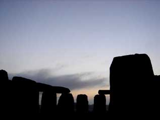 Stonehenge at sunrise on the shortest day of the year.  Salisbury Plain Britain