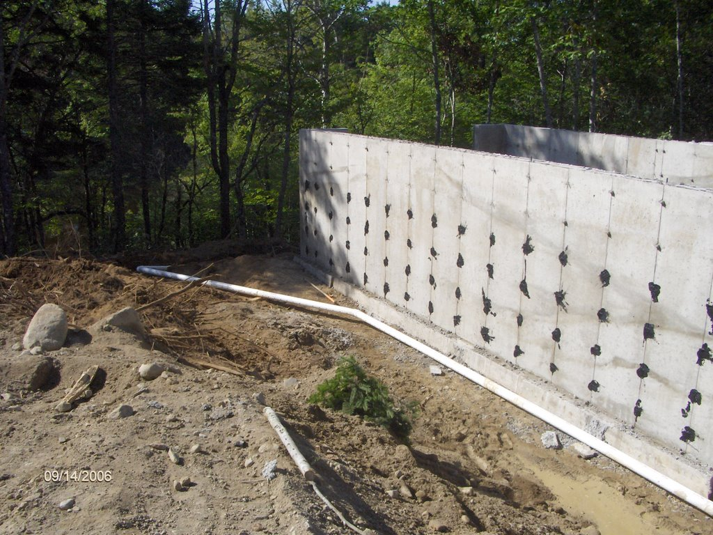 Maine cottage foundation insulation drainage and rock wall for Rock wall insulation
