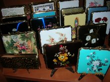 An Intresting Collection of Ashtrays Compacts & Cases.
