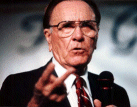 Oral Roberts - is he sticking two fingers up at his gullible audience, or perhaps the IRS?