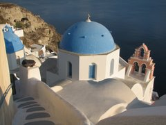 Blue domed churches in Oia, Santorini...