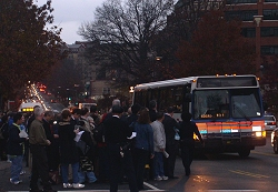 Another packed bus takes off for Farragut North.