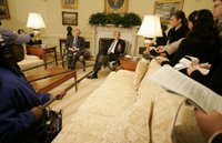 President George W. Bush speaks to reporters as he sits with NATO Secretary-General Jaap de Hoop Scheffer in the Oval Office Friday, Oct. 27, 2006. White House photo by Kimberlee Hewitt.