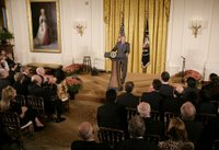 President George W. Bush welcomes invited guests Friday, Oct. 6, 2006 to the East Room of the White House, White House photo by Kimberlee Hewitt.