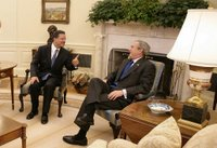 President George W. Bush meets with President Leonel Fernandez of the Dominican Republic in the Oval Office Wednesday, Oct. 25, 2006. White House photo by Eric Draper.