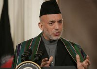 President Hamid Karzai, of the Islamic Republic of Afghanistan, responds to a reporter's question Tuesday, Sept. 26, 2006, during a joint availability with President George W. Bush in the East Room of the White House. Said President Karzai,