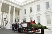 Mrs. Laura Bush stands with the Botek family of Lehighton, Pa., as she receives the official White House Christmas tree on the North Portico Monday, Nov. 27, 2006. The Botek family owns Crystal Springs Tree Farm and donated the 18-foot Douglas fir tree. White House photo by Shealah Craighead.