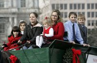 Some of the younger members of the Botek family bring in the official White House Christmas tree to Mrs. Laura Bush on the North Portico Monday, Nov. 27, 2006. The Botek family owns Crystal Springs Tree Farm and donated the 18-foot Douglas fir tree. White House photo by Kimberlee Hewitt.
