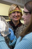 Jamie Mullally '07, right, a Cornell Presidential Research Scholar, and Margaret Frey, assistant professor of textiles and apparel, examine a nonwoven nanofiber fabric on aluminum foil backing. Mullally will complete an honors thesis on the biorecognition fabrics in spring '07. Copyright © Cornell University