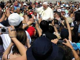 Egged on by Pope Benedict, the crowd prepare to burn their evil 21st Century cameras