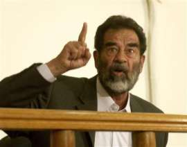 Saddam begins one of the big musical numbers