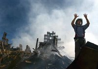 A New York City fireman calls for 10 more rescue workers to make their way into the rubble of the World Trade Center, Sept. 15, 2001. Photo by Photographer's Mate 1st Class Preston Keres, USN