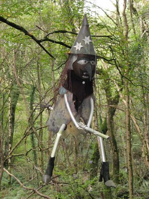 a terrifying witch in the trees