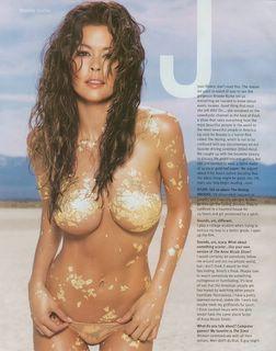 Brooke Burke covered in gold foil
