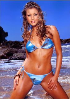 singer Holly Valance looking cute in a  blue bikini