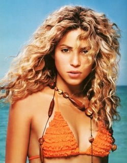 Shakira looking hot in a orange bikini