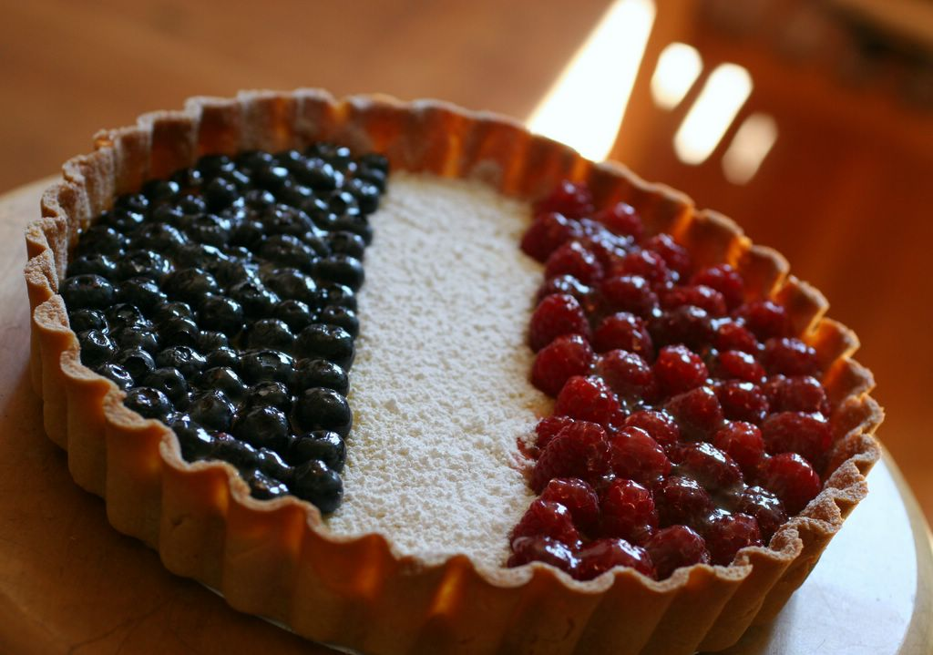 photograph picture tarte au citron lemon tart from a recipe by pierre herme in the cooks book with the addition of fruit blueberries and raspberries to make it look by the french flag