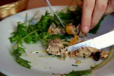 photograph picture of two knives fighting over a rabbit pate at Le Sept Quinze, Bistro Restaurant, Paris